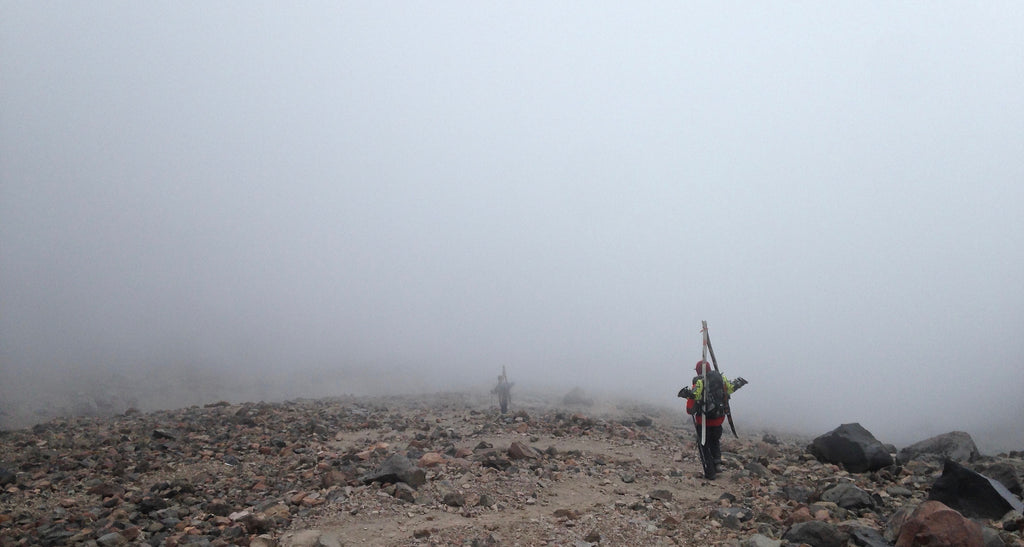 Drew and Dave drop through the clouds on the return hike to Piedra Grande
