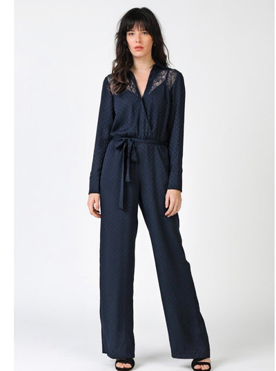 CA  Navy Subtle Polka Dot Jacquard Long Sleeve Surplice Neck Jumpsuit with Lace Trim.