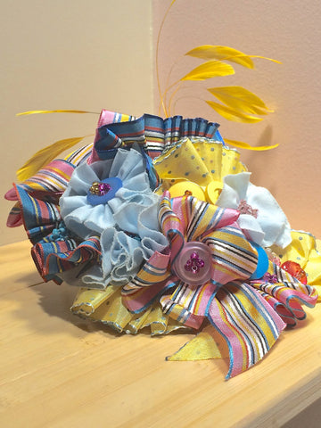 Fascinator in pink yellow and blue!