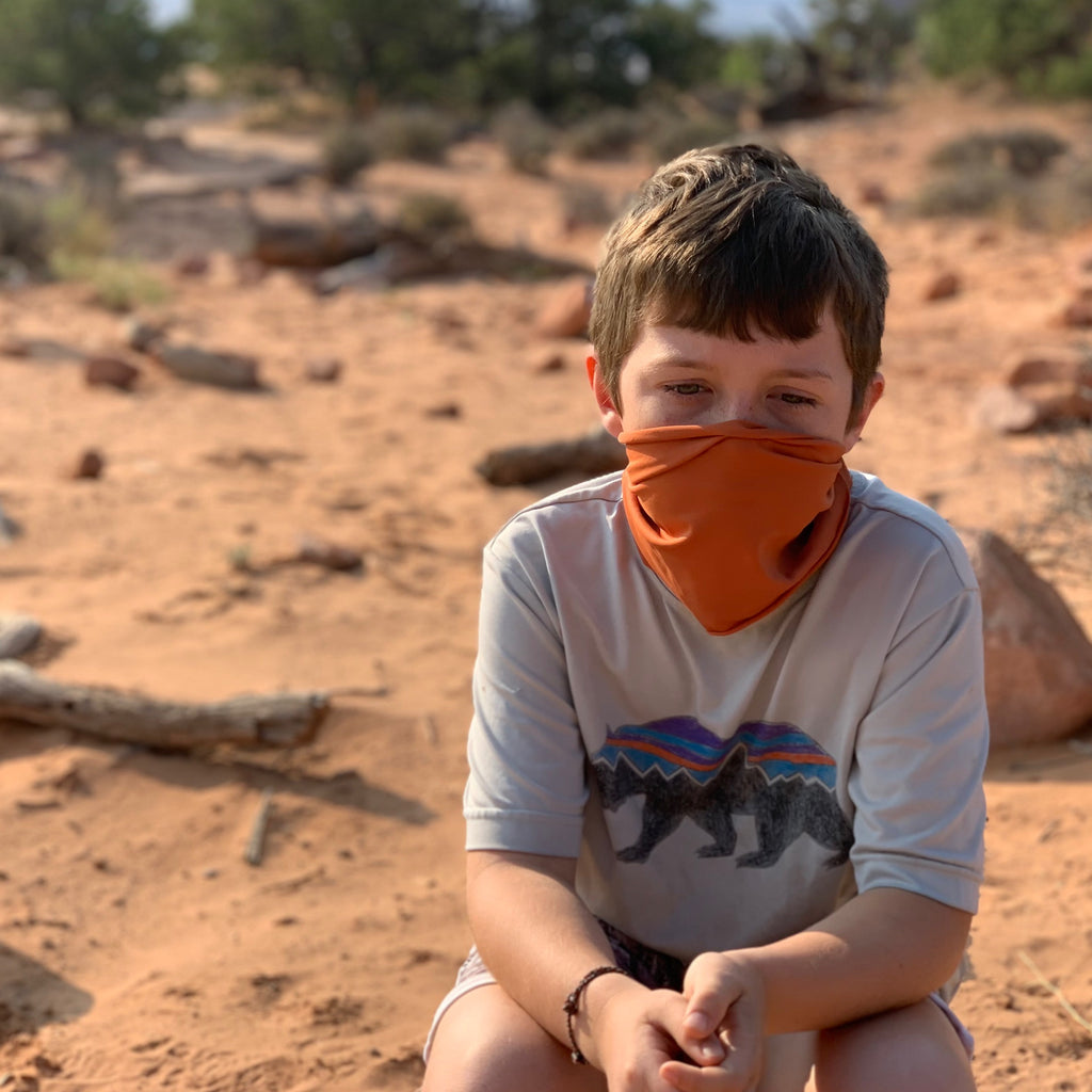 A TerraCotta / Orange Face Covering / Neck Gaiter perfect for hiking, adventures, and just ordinary everyday activities where a  facemask is required.