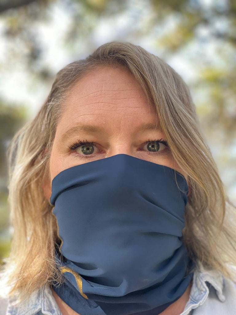 A Marino / Navy Blue Face Covering / Neck Gaiter perfect for hiking, adventures, and just ordinary everyday activities where a  facemask is required.