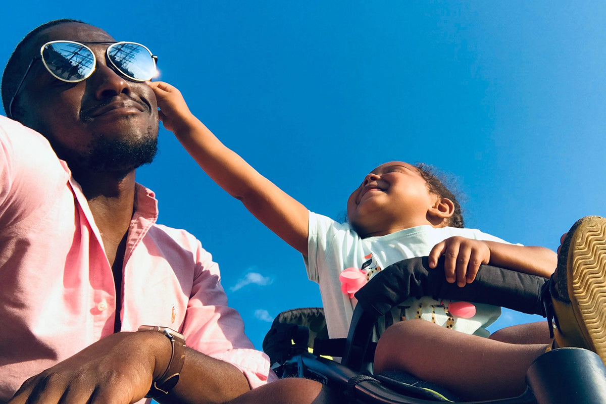 Travelling with Kids: A Survival Guide - toddler playfully removing fathers sunglasses