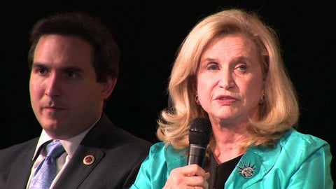 "US Congresswoman Carolyn Maloney wearing the ""National Women's History Museum"" pin design by Michele Benjamin"
