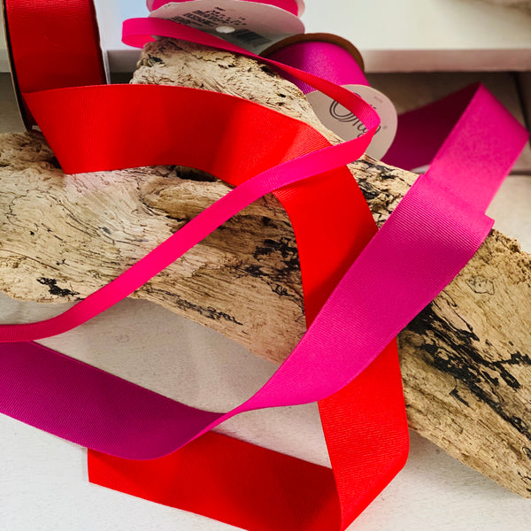 driftwood with red and pink ribbon over it