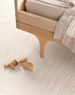 hand-loomed rug / ivory