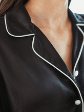 Load image into Gallery viewer, Close up of silk fabric and collar of black silk pyjama top