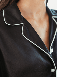 Close up of silk fabric and collar of black silk pyjama top