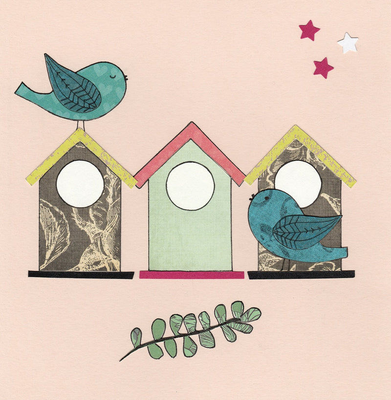 Greeting Card with pink background featuring 2 blue birds and multi coloured birdhouses. Good to give for housewarming or any occasion. Made by Mr Kite Designs