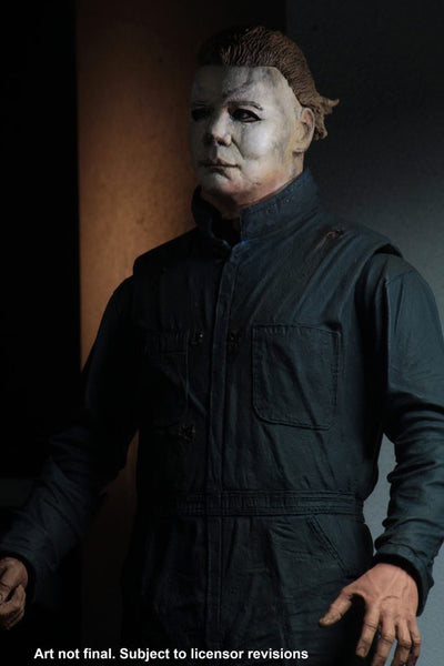 This is a Halloween II Michael Myers NECA action figure and he is wearing a white mask with light brown hair, with green blue coveralls..