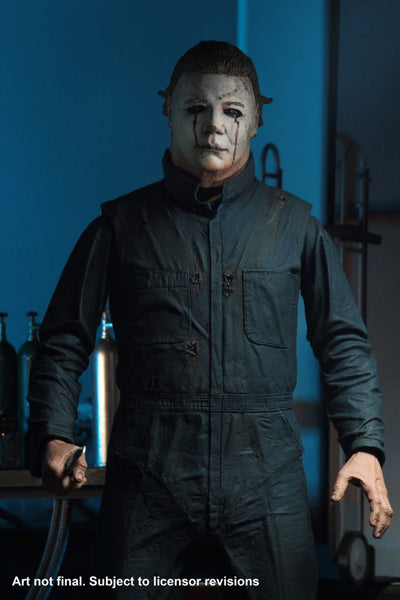 This is a Halloween II Michael Myers NECA action figure and he is wearing a white mask with dark blonde hair, with green blue coveralls..