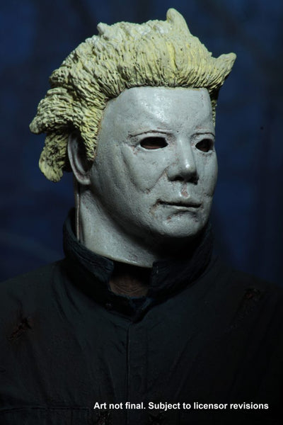 This is a Halloween II Michael Myers NECA action figure and he is wearing a white Ben Tramer mask with yellow hair, with green blue coveralls..