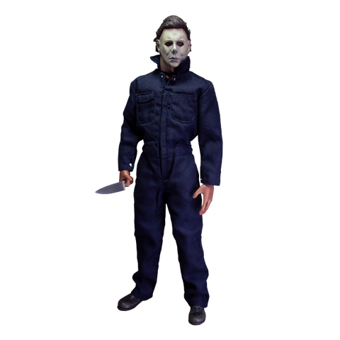 This is a Halloween 1978 Michael Myers action figure and he has a white face, brown hair, blue coveralls and he is holding a silver knife.