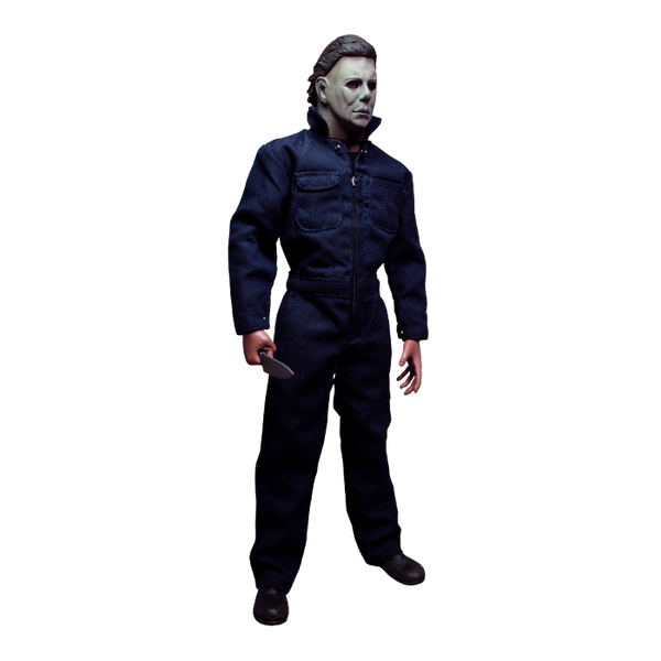 This is a Halloween 1978 Michael Myers action figure and he has a white face, brown hair, blue coveralls and he is holding a silver knife while turned to the left.