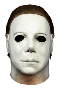 This is a Halloween 1978 Boogeyman Michael Myers mask and it is a white face, with brown hair.