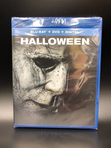 This is an image of Michael Myers in a mask from Halloween 2018 and includes the box art for the Blu-Ray, DVD, Digital Copy and Special and Bonus Features, including deleted and extended scenes.