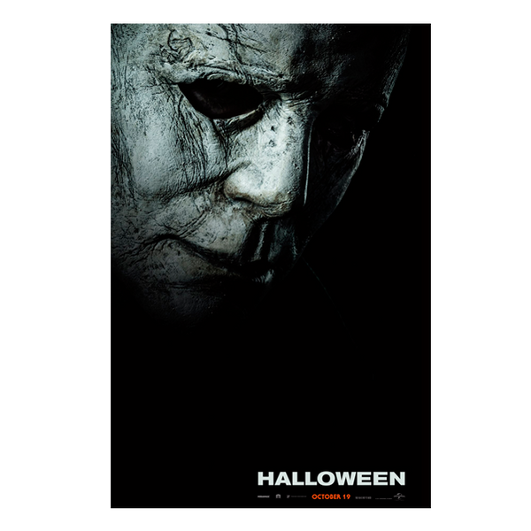 This is a Halloween 2018 Michael Myers poster with a mask that is weathered grey face and has the word Halloween on it.