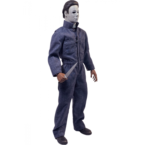 This is a Halloween 4 Return of Michael Myers Trick Or Treat Action Figure and he has a white mask, blue coveralls, black boots, burnt hand that are holding a silver knife.