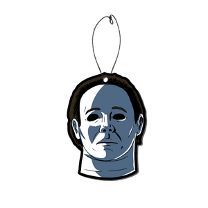 This is a Halloween 4 Return of Michael Myers air freshener and he has a white face, brown hair and black eyes.