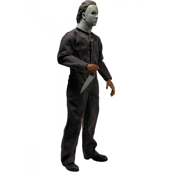 This is a Halloween 5 Revenge of Michael Myers Trick Or Treat Action Figure and he has a white mask, grey coveralls, black boots, burnt hand that are holding a silver knife.