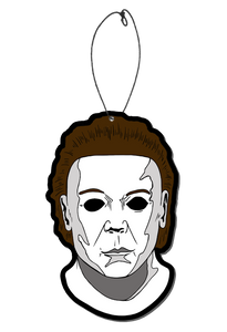 This is a Michael Myers Halloween 8 Resurrection air freshener that is a white face, brown hair, black eyes and a plastic hanger.