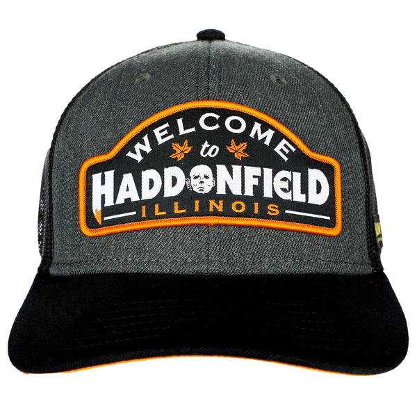 This is a grey Halloween movie Haddonfield Michael Myers baseball hat with black mesh and back bill and orange embroidery on the patch.