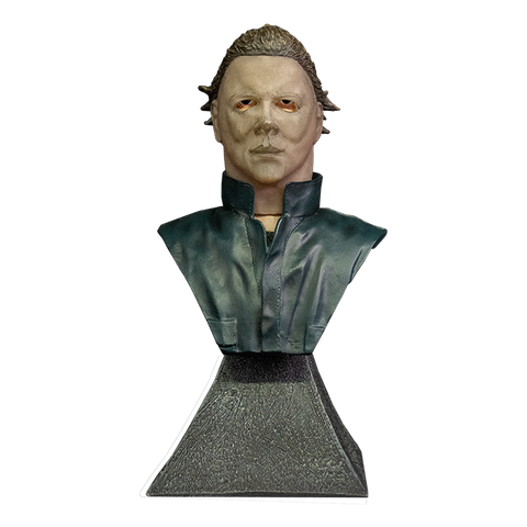 This is a Halloween II Michael Myers mini bust and he is wearing a mask, has brown hair and blue coveralls.