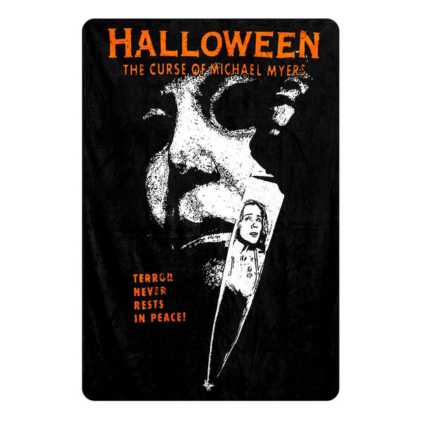 This is a Halloween 6 Curse of Michael Myers fleece throw that is black and orange and he is holding a knife with the reflection of a girl in it.