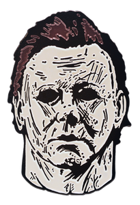 This is a Michael Myers enamel pin from Halloween 2018 and he has a white mask with brown hair and black eyes.