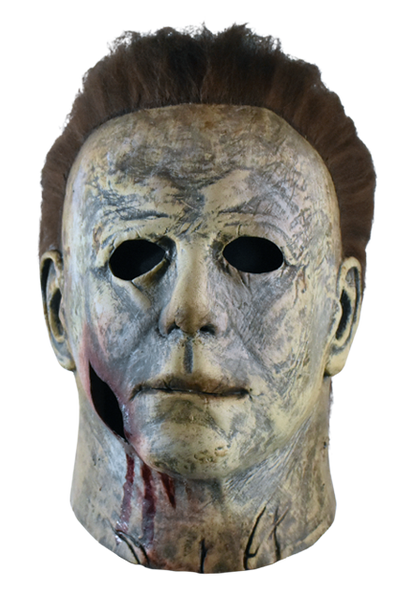 This is a weathered Michael Myers mask bloody edition from Halloween 2018 and it is grey and brown with brown hair and black eyes.