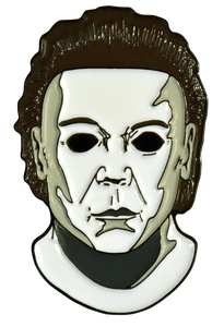 This is a Michael Myers pin from Halloween 8 Resurrection and it is a white face with brown hair and black eyes.