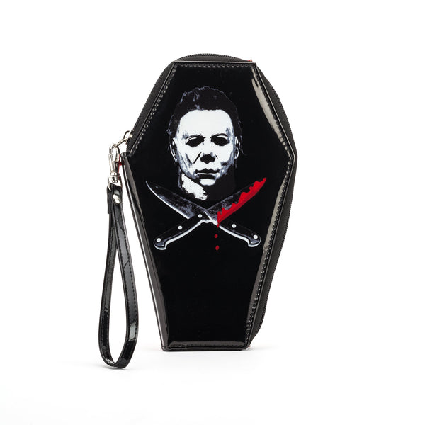 This is a Halloween Michael Myers coffin shaped wallet and it is black with a white mask, two crossed knives with blood.  Edit alt text