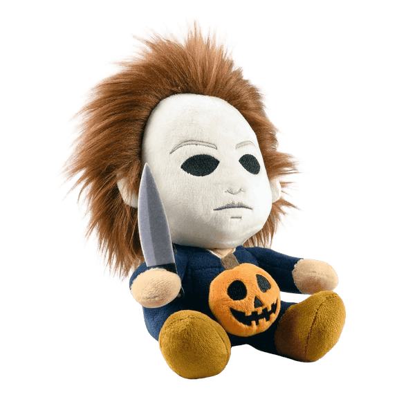 This is the side of a Kidrobot Halloween Michael Myers Phunny stuffed plush that has a white face, brown hair, blue coveralls, a silver knife and orange pumpkin.