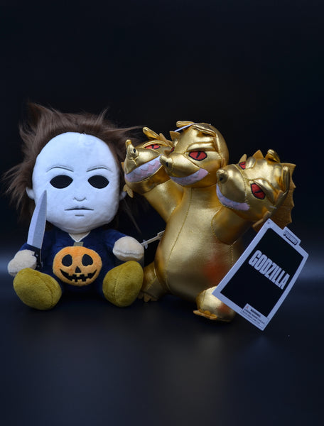 This is a Michael Myers Halloween Phunny plush stuffed with a gold Godzilla