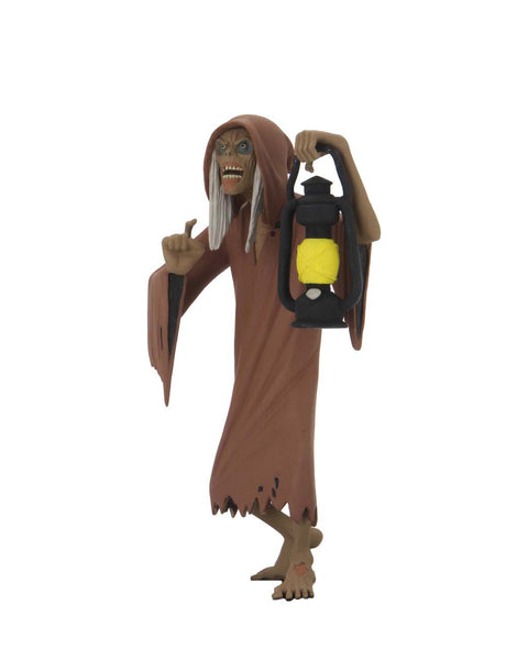 This is NECA Toony Terror Series 5 Creepshow Creep and he has white hair, is wearing a brown nightgown, is barefoot and is holding a lantern.  Edit alt text
