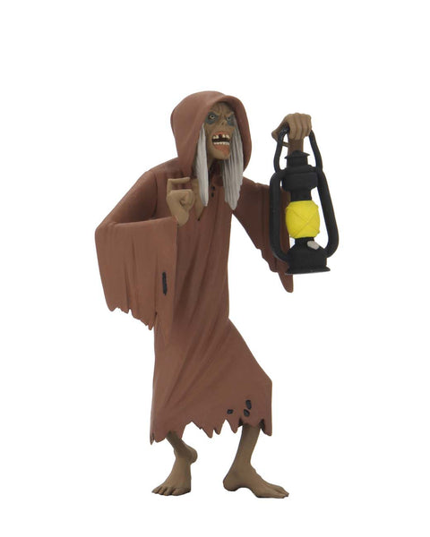 This is NECA Toony Terror Series 5 Creepshow Creep and he has on a brown nightgown, is barefoot and is holding a lantern.  Edit alt text