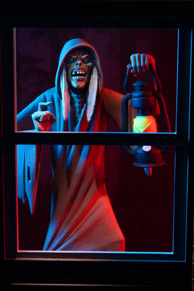 This is NECA Toony Terror Series 5 Creepshow Creep and he has white hair, is wearing a brown nightgown and is holding a lantern.  Edit alt text
