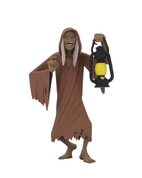This is NECA Toony Terror Series 5 Creepshow Creep and he has on a brown nightgown and is holding a lantern.  Edit alt text