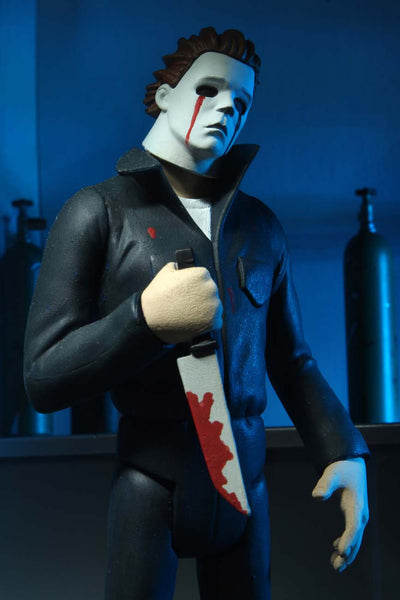 This is NECA Toony Terror Series 5 Halloween 2 Michael Myers and he has w white mask with blood tears and is holding a bloody knife and wearing coveralls.  Edit alt text