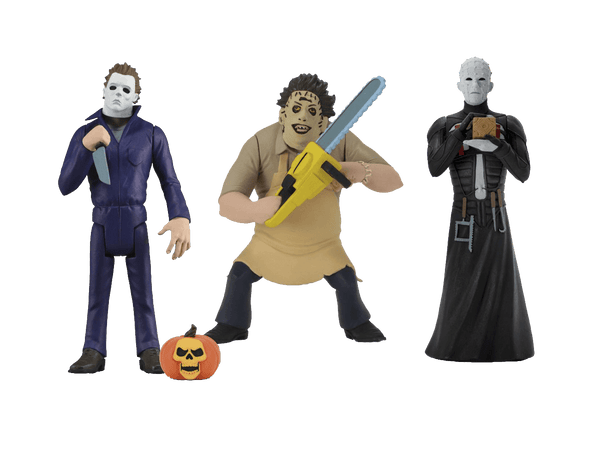 Toony Terrors Michael Myers is holding a knife, with a pumpkin and Leatherface is standing with a chainsaw, while Pinhead stands in a black leather dress with a brown box.