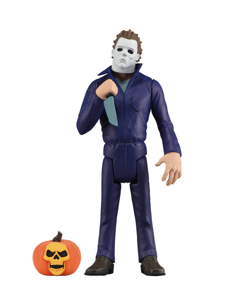 Michael Myers is standing with a knife in his hand, with a pumpkin at his feet, in front of a white background.