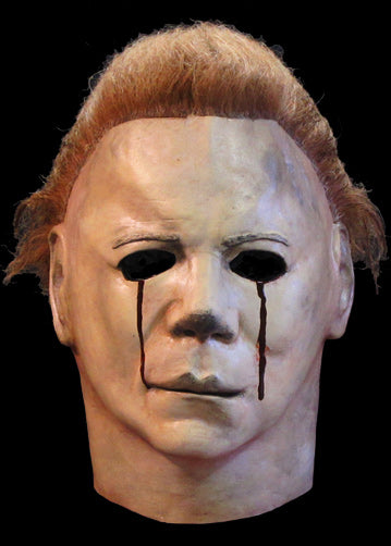 This is a Halloween 2 Michael Myers mask that is white, with brown hair and blood tears.