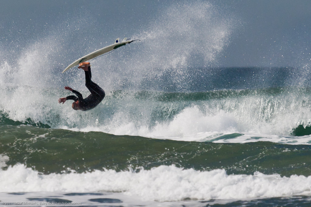 Surfer flipping on a top turn