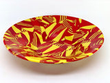 red and yellow recycled glass bowl