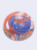 clear glass with blue and red swirls paperweight