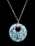 blue and white pendant necklace on silver chain