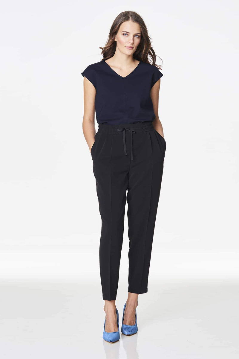 Voglia dark blue cap sleeve top with black pants