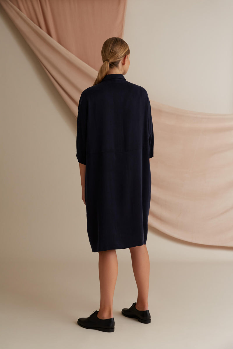Voglia Alaia shirt dress blue behind