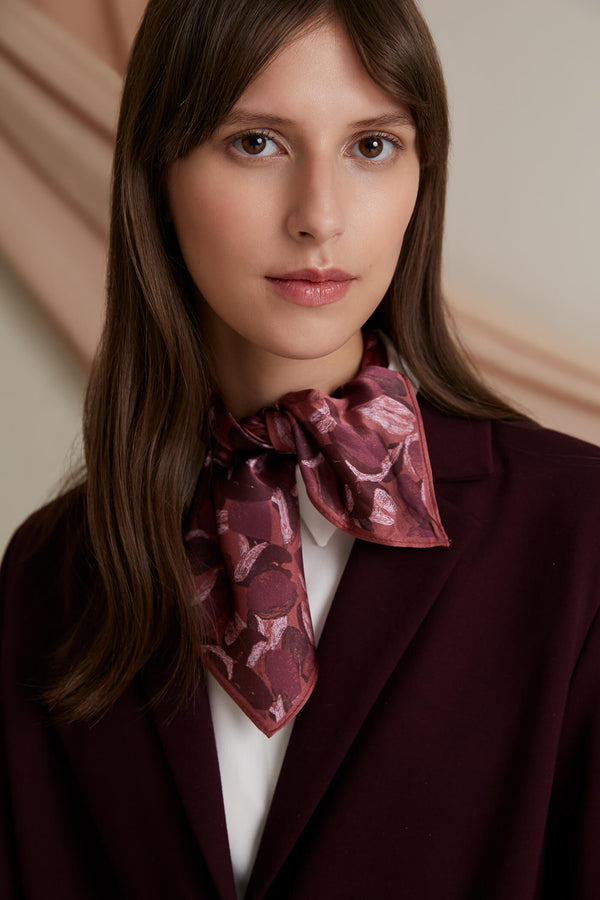 Voglia Arden patterned silk scarf marsala tied