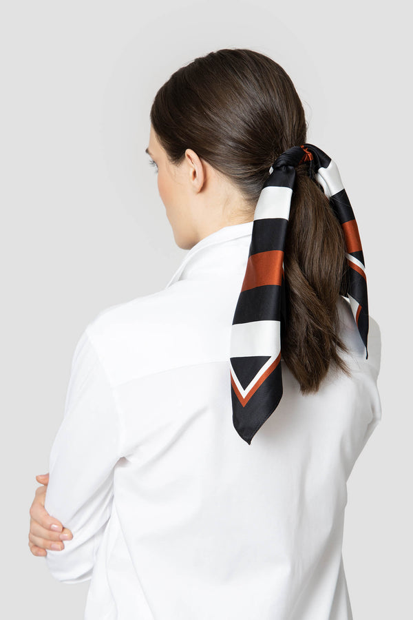 Voglia Finland women's orange silk scarf ponytail