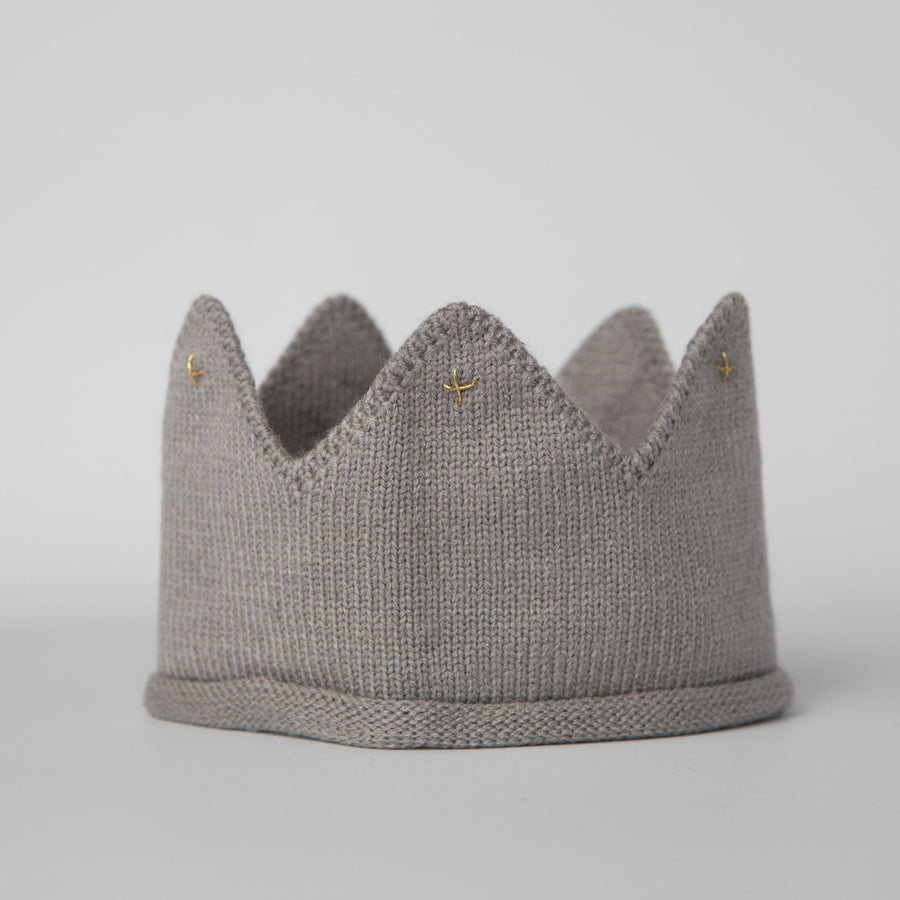 Gray knitted crown with gold accents